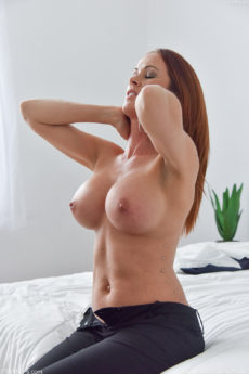 Big tits redhead Sabrina takes a big cock on